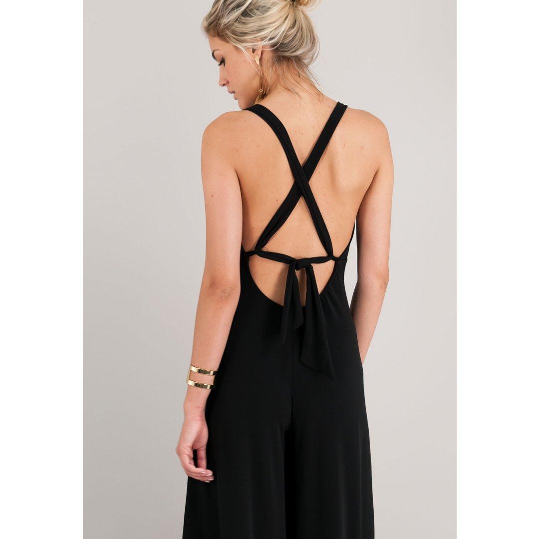 Μαύρη ολόσωμη φόρμα με δετές τιράντες και ανοιχτή πλάτη. ενδυματα   jumpsuits playsuits